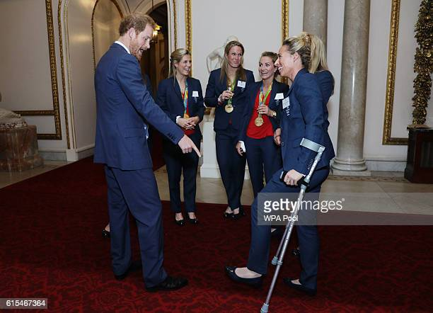 Prince Harry meets the Ladies Hockey Team with Susannah Townsend on crutches at a reception for Team GB's 2016 Olympic and Paralympic teams hosted by...