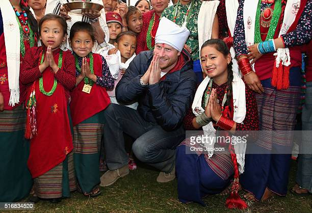 Prince Harry meets villagers during a visit to the village of Leorani in the Himalayan foothills on day three of his visit to Nepal on March 21 2016...
