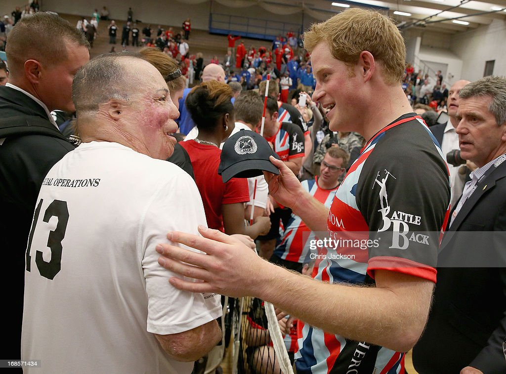 <a gi-track='captionPersonalityLinkClicked' href=/galleries/search?phrase=Prince+Harry&family=editorial&specificpeople=178173 ng-click='$event.stopPropagation()'>Prince Harry</a> meets Warrior Games competitors after a seated vollyball exhibition match during the Warrior Games during the third day of his visit to the United States on May 11, 2013 in Colorado Springs, Colorado. HRH will be undertaking engagements on behalf of charities with which the Prince is closely associated on behalf also of HM Government, with a central theme of supporting injured service personnel from the UK and US forces.