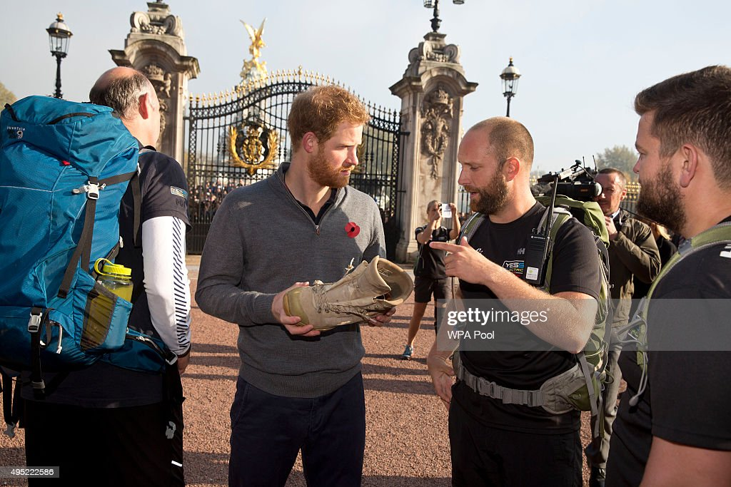 Prince Harry meets with members of the Walking With The Wounded team in the forecourt of Buckingham Palace after their latest endeavour, the Walk Of Britain on November 1, 2015 in London, England. Six members of the Walk of Britain team concluded their 1000-mile trek, which began on 22 August in Scotland and continued through the length and breadth of the country to London.