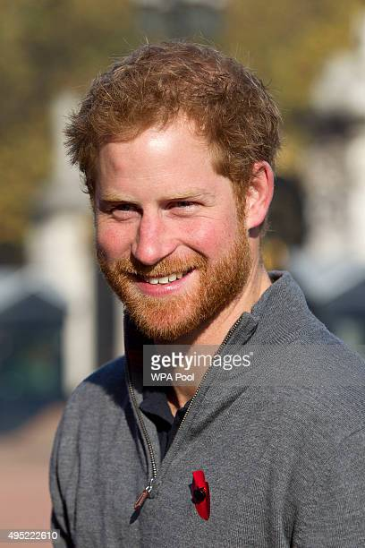 Prince Harry meets with members of the Walking With The Wounded team in the forecourt of Buckingham Palace after their latest endeavour the Walk Of...