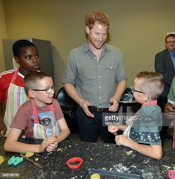 Prince Harry meets young boys as he visits the Wigan Youth Zone a purposebuilt youth facility that provides a safe and fun environment for 819...