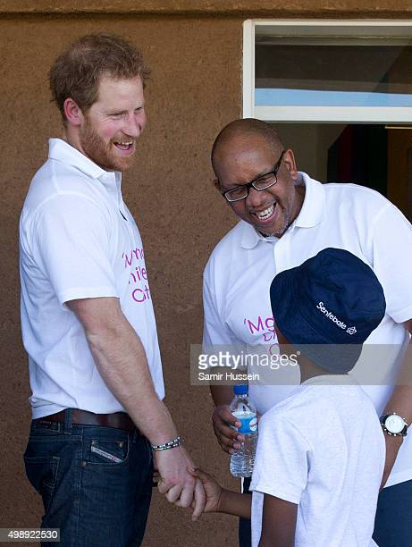 Prince Harry meets young children as he tours the opening of Sentebale's Mamohato Children's Centre during an official visit to Africa on November 26...