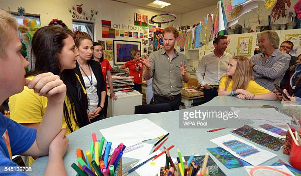 Prince Harry meets young people as he visits the Wigan Youth Zone a purposebuilt youth facility that provides a safe and fun environment for 819...