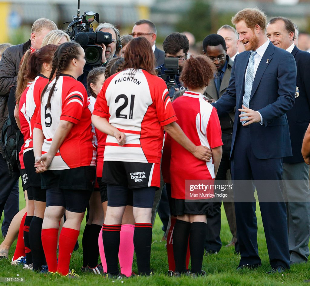 Prince Harry meets young players as he visits Paignton Rugby Club to present them with an RFU, Gold Standard Facilities Award on October 7, 2015 in Paignton, England.