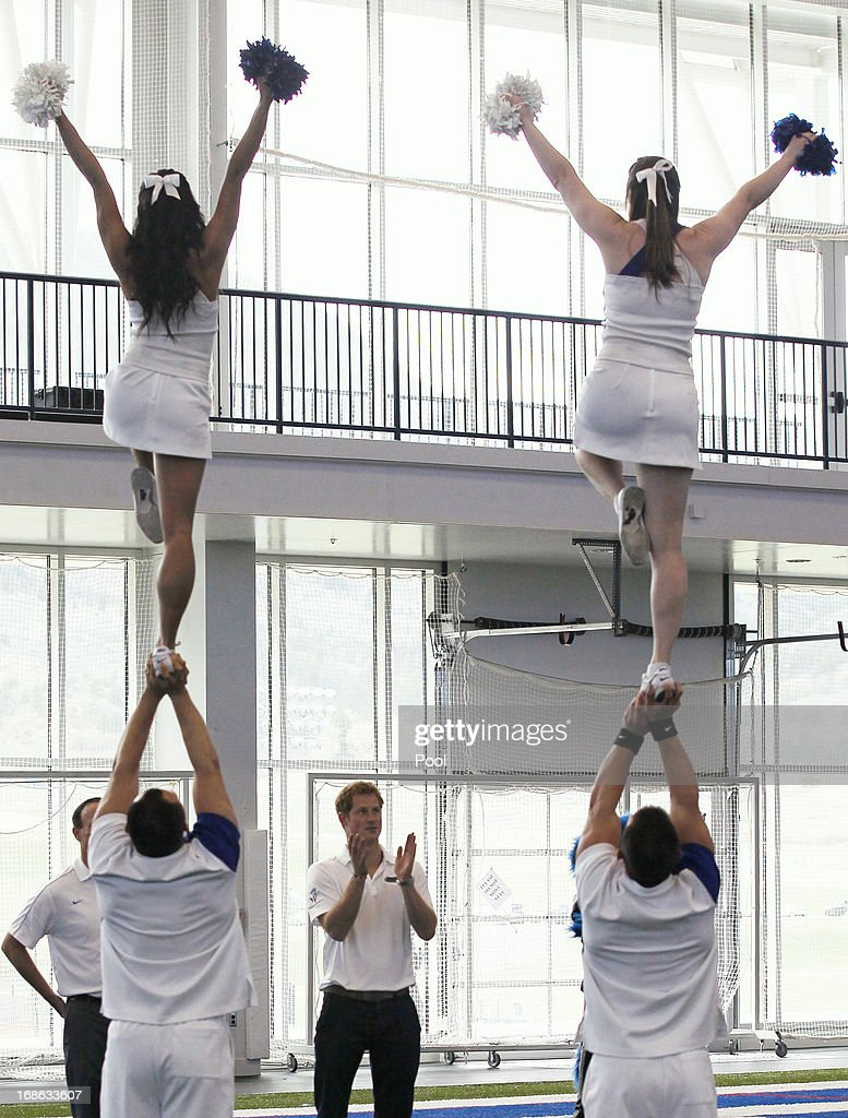 HRH Prince Harry observes a cheerleading demonstration at the United States Air Force Academy's football training center during the fourth day of his visit to the United States on May 12, 2013 in Colorado Springs, Colorado. HRH will be undertaking engagements on behalf of charities with which the Prince is closely associated on behalf also of HM Government, with a central theme of supporting injured service personnel from the UK and US forces.