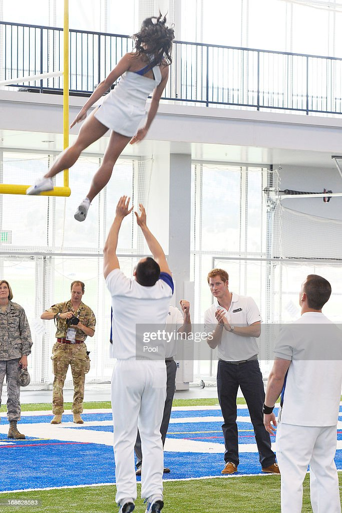HRH <a gi-track='captionPersonalityLinkClicked' href=/galleries/search?phrase=Prince+Harry&family=editorial&specificpeople=178173 ng-click='$event.stopPropagation()'>Prince Harry</a> observes cheerleaders at the United States Air Force Academy's football training center during the fourth day of his visit to the United States on May 12, 2013 in Colorado Springs, Colorado. HRH will be undertaking engagements on behalf of charities with which the Prince is closely associated on behalf also of HM Government, with a central theme of supporting injured service personnel from the UK and US forces.