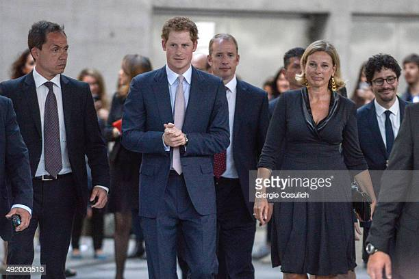 Prince Harry of Great Britain and President of Maxxi Museum Giovanna Melandri leave the Maxxi Museum on May 18 2014 in Rome Italy Prince Harry is on...