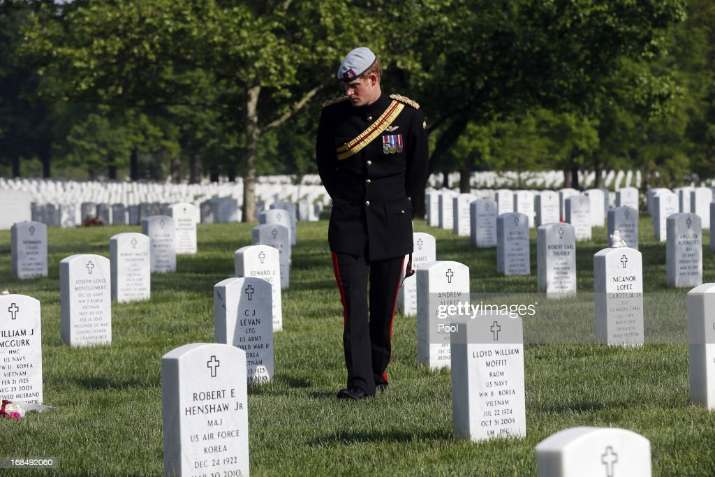 Prince Harry of Great Britain, wearing his British Army uniform in his role as Captain Harry Wales, visits Section 60 of Arlington National Cemetery, where veterans of the wars in Iraq and Afghanistan are buried, on May 10, 2013 in Arlington Virginia. During his visit to the US, Prince Harry will be undertaking engagements on behalf of charities with which he is closely associated, on behalf also of HM Government, with a central theme of supporting injured service personnel from the UK and US forces.