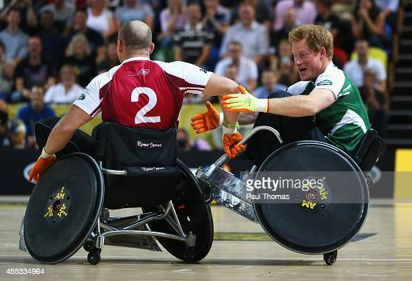 Prince Harry of Invictus is challenged by Mike Tindall of Endeavour during the Jaguar Land Rover Exhibition Wheelchair Rugby Match during day 2 of...