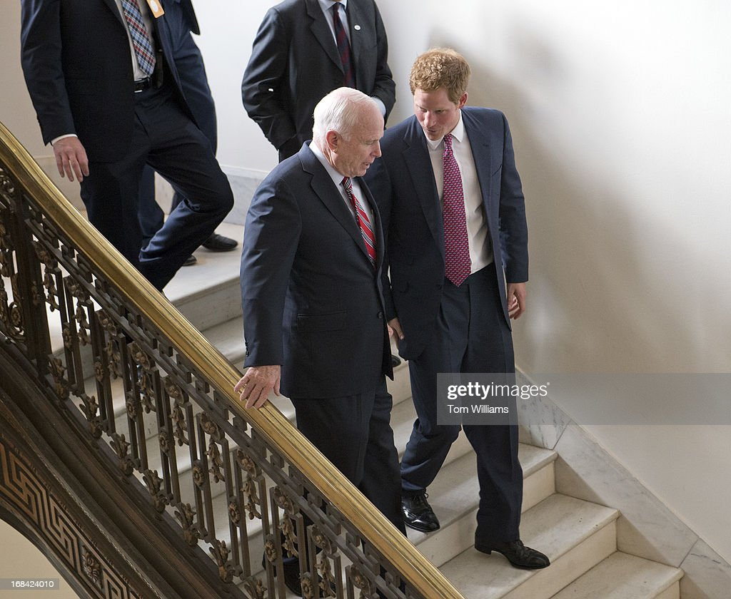 Prince Harry of Wales and Sen. John McCain, R-Ariz., leave Russell Building after viewing an anti-landmine photo exhibit sponsored by the HALO Trust. This is the first stop on Prince Harry's seven day trip around the U.S.