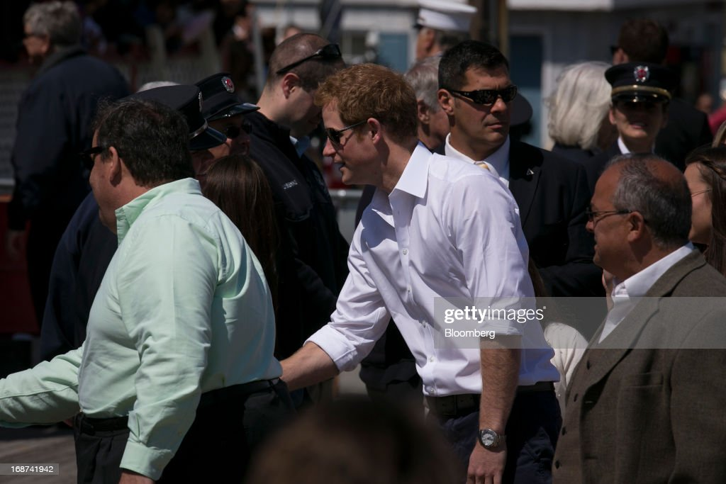 <a gi-track='captionPersonalityLinkClicked' href=/galleries/search?phrase=Prince+Harry&family=editorial&specificpeople=178173 ng-click='$event.stopPropagation()'>Prince Harry</a> of Wales, center, and <a gi-track='captionPersonalityLinkClicked' href=/galleries/search?phrase=Chris+Christie&family=editorial&specificpeople=6480114 ng-click='$event.stopPropagation()'>Chris Christie</a>, governor of New Jersey, view areas of the boardwalk in Seaside Heights, New Jersey, U.S., on Tuesday, May 14, 2013. Seaside Heights Mayor William Akers is looking forward to showing off the improvement as the prince visits, part of a week-long U.S. tour that also includes stops in Washington, Colorado and New York. Photographer: Scott Eells/Bloomberg via Getty Images