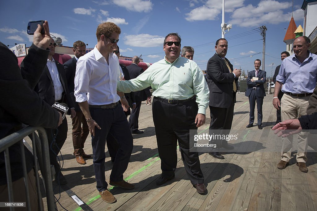 Prince Harry of Wales, left, and Chris Christie, governor of New Jersey, view areas of the boardwalk in Seaside Heights, New Jersey, U.S., on Tuesday, May 14, 2013. Seaside Heights Mayor William Akers is looking forward to showing off the improvement as the prince visits, part of a week-long U.S. tour that also includes stops in Washington, Colorado and New York. Photographer: Scott Eells/Bloomberg via Getty Images