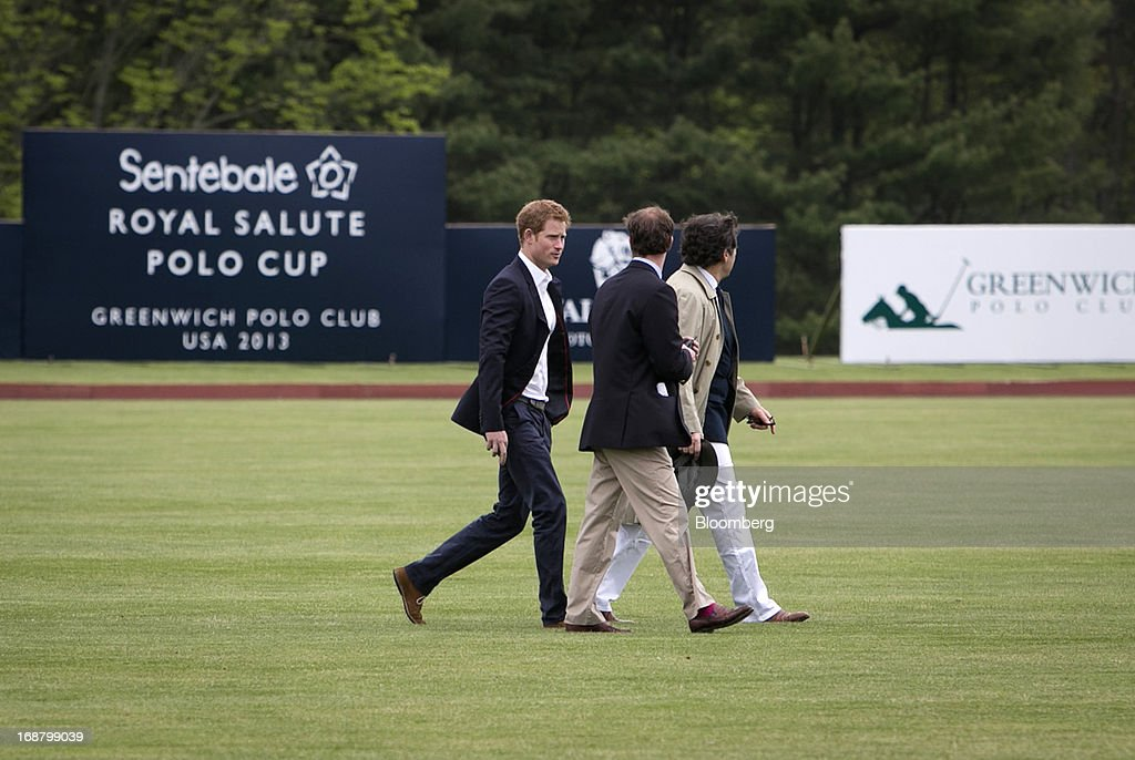 <a gi-track='captionPersonalityLinkClicked' href=/galleries/search?phrase=Prince+Harry&family=editorial&specificpeople=178173 ng-click='$event.stopPropagation()'>Prince Harry</a> of Wales, left, walks across the field before the Sentebale Royal Salute Polo Cup at the Greenwich Polo Club in Greenwich, Connecticut, U.S., on Wednesday, May 15, 2013. <a gi-track='captionPersonalityLinkClicked' href=/galleries/search?phrase=Prince+Harry&family=editorial&specificpeople=178173 ng-click='$event.stopPropagation()'>Prince Harry</a>'s visit is part of a week-long U.S. tour that also includes stops in Washington, Colorado and New York. Photographer: Scott Eells/Bloomberg via Getty Images