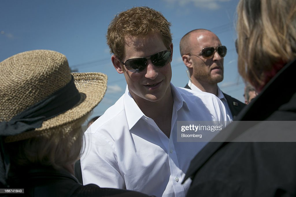<a gi-track='captionPersonalityLinkClicked' href=/galleries/search?phrase=Prince+Harry&family=editorial&specificpeople=178173 ng-click='$event.stopPropagation()'>Prince Harry</a> of Wales shakes hands as he views areas of the boardwalk in Seaside Heights, New Jersey, U.S., on Tuesday, May 14, 2013. Seaside Heights Mayor William Akers is looking forward to showing off the improvement as the prince visits, part of a week-long U.S. tour that also includes stops in Washington, Colorado and New York. Photographer: Scott Eells/Bloomberg via Getty Images