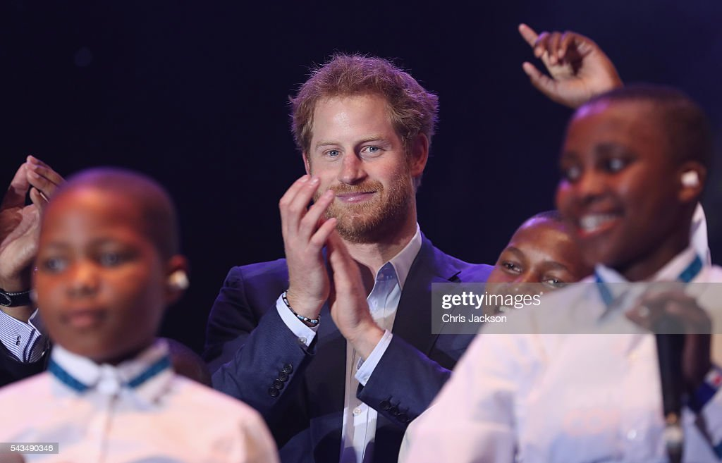 <a gi-track='captionPersonalityLinkClicked' href=/galleries/search?phrase=Prince+Harry&family=editorial&specificpeople=178173 ng-click='$event.stopPropagation()'>Prince Harry</a> on stage with the Basotho Children's choir at the finale of the Sentebale Concert at Kensington Palace on June 28, 2016 in London, England. Sentebale was founded by <a gi-track='captionPersonalityLinkClicked' href=/galleries/search?phrase=Prince+Harry&family=editorial&specificpeople=178173 ng-click='$event.stopPropagation()'>Prince Harry</a> and Prince Seeiso of Lesotho over ten years ago. It helps the vulnerable and HIV positive children of Lesotho and Botswana.