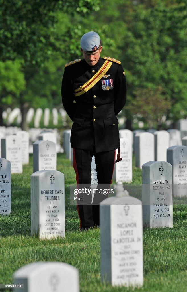 <a gi-track='captionPersonalityLinkClicked' href=/galleries/search?phrase=Prince+Harry&family=editorial&specificpeople=178173 ng-click='$event.stopPropagation()'>Prince Harry</a> participates in a ceremonial wreath laying at the Tomb of the Unknowns during the second day of his visit to the United States at Arlington National Cemetery on May 10, 2013 in Arlington, Virginia. HRH will be undertaking engagements on behalf of charities with which the Prince is closely associated on behalf also of HM Government, with a central theme of supporting injured service personnel from the UK and US forces.