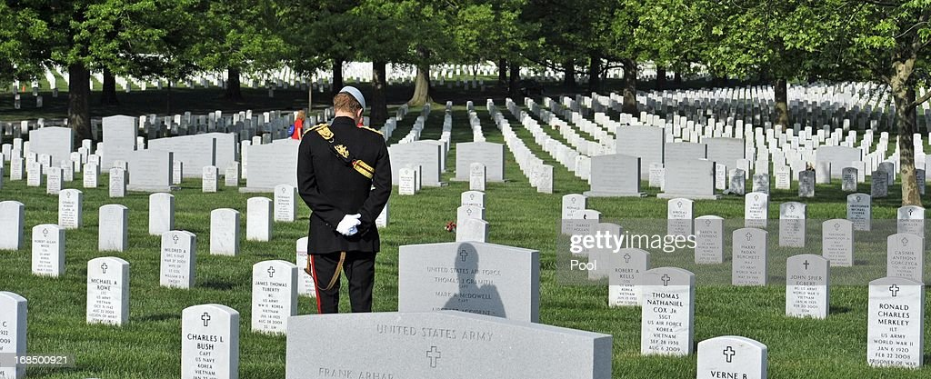 Prince Harry participates in a ceremonial wreath laying at the Tomb of the Unknowns during the second day of his visit to the United States at Arlington National Cemetery on May 10, 2013 in Arlington, Virginia. HRH will be undertaking engagements on behalf of charities with which the Prince is closely associated on behalf also of HM Government, with a central theme of supporting injured service personnel from the UK and US forces.
