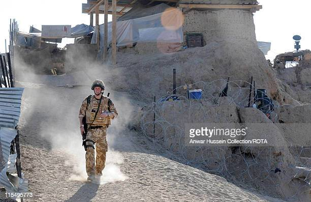 Prince Harry patrols the deserted town of Garmisir on January 2 2008 in Helmand Province Afghanistan