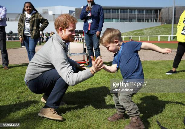 Prince Harry Patron of the Invictus Games Foundation plays with Harry Phillips aged two and a half as he attends the UK team trials for the Invictus...