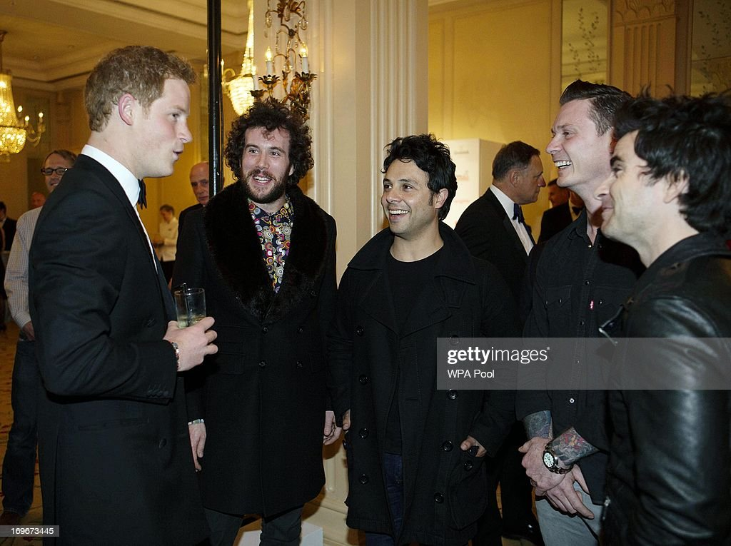 <a gi-track='captionPersonalityLinkClicked' href=/galleries/search?phrase=Prince+Harry&family=editorial&specificpeople=178173 ng-click='$event.stopPropagation()'>Prince Harry</a>, Patron of the Walking With The Wounded South Pole Allied Challenge, speaks with The Stereophonics at the Walking With The Wounded Crystal Ball Gala Dinner at The Grosvenor House Hotel on May 30, 2013 in London, England.