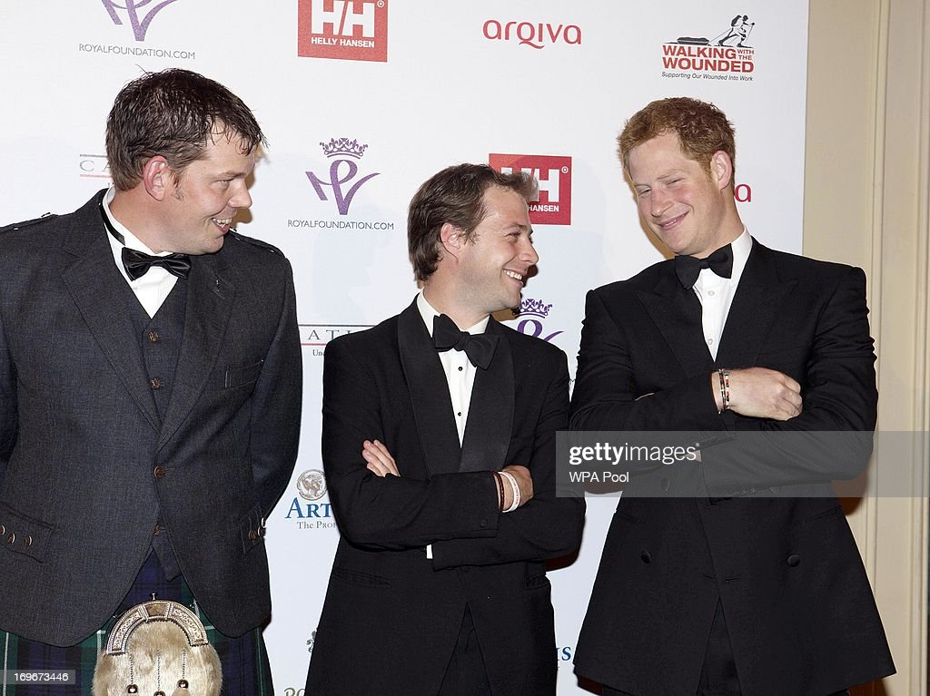 <a gi-track='captionPersonalityLinkClicked' href=/galleries/search?phrase=Prince+Harry&family=editorial&specificpeople=178173 ng-click='$event.stopPropagation()'>Prince Harry</a> (R), Patron of the Walking With The Wounded South Pole Allied Challenge, speaks with Duncan Slater (L) and Guy Disney at the Walking With The Wounded Crystal Ball Gala Dinner at The Grosvenor House Hotel on May 30, 2013 in London, England.