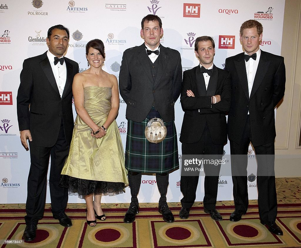 <a gi-track='captionPersonalityLinkClicked' href=/galleries/search?phrase=Prince+Harry&family=editorial&specificpeople=178173 ng-click='$event.stopPropagation()'>Prince Harry</a> (R), Patron of the Walking With The Wounded South Pole Allied Challenge, poses with Glenfiddich Ibrar Ali , Kate Philp , Duncan Slater and Guy Disney at the Walking With The Wounded Crystal Ball Gala Dinner at The Grosvenor House Hotel on May 30, 2013 in London, England.