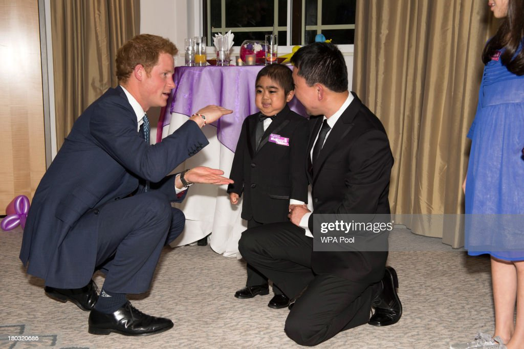 <a gi-track='captionPersonalityLinkClicked' href=/galleries/search?phrase=Prince+Harry&family=editorial&specificpeople=178173 ng-click='$event.stopPropagation()'>Prince Harry</a>, Patron of WellChild (L) chats to Jonathan He, age 6 and his father Ning, while attending the 8th annual WellChild Awards at Dorchester Hotel, Park Lane on September 11, 2013 in London, England. Jonathan, won the 'Most Inspirational Child' award for boys aged three to six years old, for his bravery in battling a life-threatening illness. The WellChild national charitable organisation cares for the individual needs of children coping with consequences of serious illness and complex medical conditions.