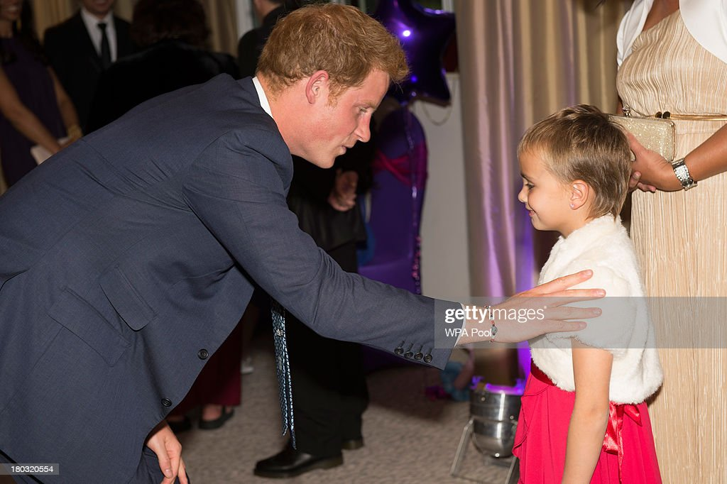<a gi-track='captionPersonalityLinkClicked' href=/galleries/search?phrase=Prince+Harry&family=editorial&specificpeople=178173 ng-click='$event.stopPropagation()'>Prince Harry</a>, Patron of WellChild (L) chats to Madison Kirk, age 6, from Grantham, while attending the 8th annual WellChild Awards at Dorchester Hotel, Park Lane on September 11, 2013 in London, England. Madison, who has undergone surgery and months of chemotherapy treatment for anaplastic large cell lymphoma, won an award in the 'Inspirational Child' category. The WellChild national charitable organisation cares for the individual needs of children coping with consequences of serious illness and complex medical conditions.