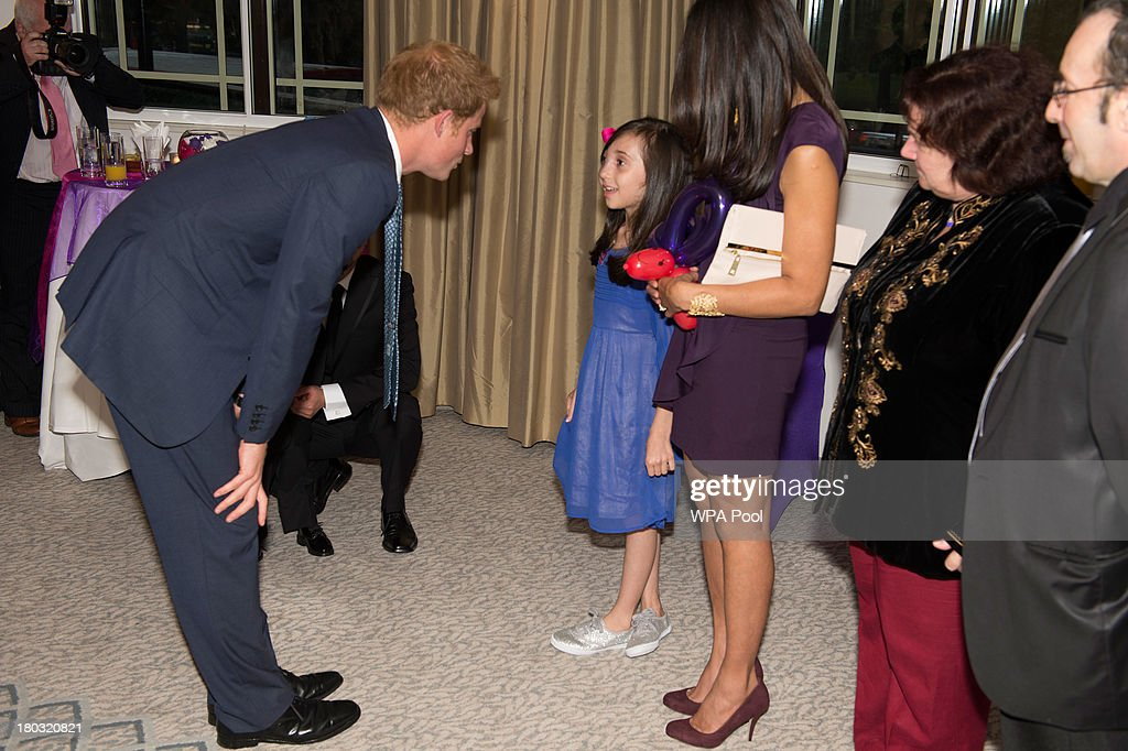 <a gi-track='captionPersonalityLinkClicked' href=/galleries/search?phrase=Prince+Harry&family=editorial&specificpeople=178173 ng-click='$event.stopPropagation()'>Prince Harry</a>, Patron of WellChild (L) chats to Nicole Christou, age 9, from Winchmore Hill, London,, while attending the 8th annual WellChild Awards at Dorchester Hotel, Park Lane on September 11, 2013 in London, England. Nicole, who suffers from the rare condition arterio-venous malformation, received a 'Most Inspirational Child' award. The WellChild national charitable organisation cares for the individual needs of children coping with consequences of serious illness and complex medical conditions.