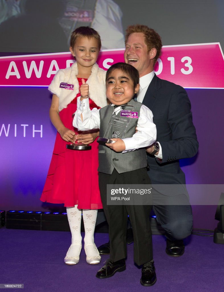 <a gi-track='captionPersonalityLinkClicked' href=/galleries/search?phrase=Prince+Harry&family=editorial&specificpeople=178173 ng-click='$event.stopPropagation()'>Prince Harry</a>, Patron of WellChild poses on stage with award winners Madison Kirk, age 6 (L) and Jonathan He, age 6, from Milton Keynes, during the 8th annual WellChild Awards at Dorchester Hotel, Park Lane on September 11, 2013 in London, England. Madison Kirk, from Grantham, who has undergone surgery and months of chemotherapy treatment for anaplastic large cell lymphoma, won an award in the 'Inspirational Child' catgory. Jonathan He won the 'Most Inspirational Child' award for boys aged three to six years old, for his bravery in battling a life-threatening illness. The WellChild national charitable organisation cares for the individual needs of children coping with consequences of serious illness and complex medical conditions.