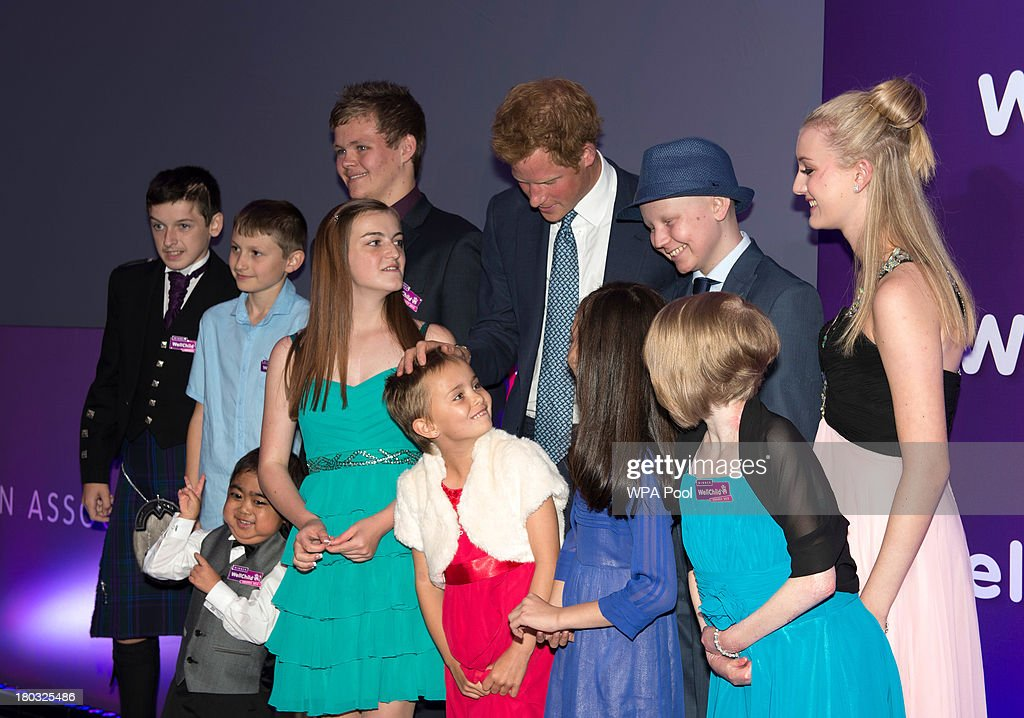 <a gi-track='captionPersonalityLinkClicked' href=/galleries/search?phrase=Prince+Harry&family=editorial&specificpeople=178173 ng-click='$event.stopPropagation()'>Prince Harry</a>, Patron of WellChild (back row, 3rd R) poses on stage with award winners, including Lauren Grace Rogers, age 17(front row, R), Nicole Christou, age 9 (front row 2nd R), Madison Kirk, age 6 (front row 3rd R) and Jonathan He, age 6 (front row, L) during the 8th annual WellChild Awards at Dorchester Hotel, Park Lane on September 11, 2013 in London, England. Madison Kirk, from Grantham, who has undergone surgery and months of chemotherapy treatment for anaplastic large cell lymphoma, won an award in the 'Inspirational Child' category. Jonathan He from Milton Keynes won the 'Most Inspirational Child' award for boys aged three to six years old, for his bravery in battling a life-threatening illness. Nicole Christou, from Winchmore Hill, London,, who suffers from the rare condition arterio-venous malformation, received a 'Most Inspirational Child' award. The WellChild national charitable organisation cares for the individual needs of children coping with consequences of serious illness and complex medical conditions.