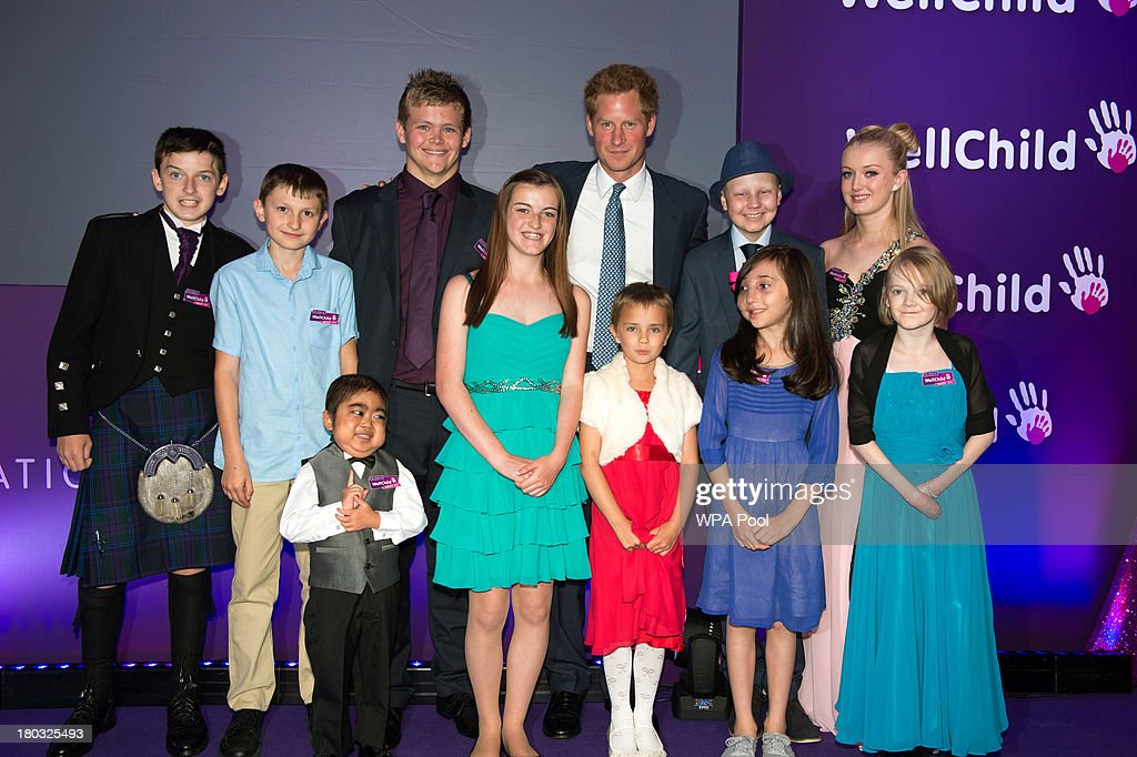 <a gi-track='captionPersonalityLinkClicked' href=/galleries/search?phrase=Prince+Harry&family=editorial&specificpeople=178173 ng-click='$event.stopPropagation()'>Prince Harry</a>, Patron of WellChild (back row, 3rd R) poses on stage with award winners, including Lauren Grace Rogers, age 17(front row, R), Nicole Christou, age 9 (front row 2nd R), Madison Kirk, age 6 (front row 3rd R) and Jonathan He, age 6 (front row, L) during the 8th annual WellChild Awards at Dorchester Hotel, Park Lane on September 11, 2013 in London, England. Madison Kirk, from Grantham, who has undergone surgery and months of chemotherapy treatment for anaplastic large cell lymphoma, won an award in the 'Inspirational Child' category. Jonathan He from Milton Keynes won the 'Most Inspirational Child' award for boys aged three to six years old, for his bravery in battling a life-threatening illness. Nicole Christou, from Winchmore Hill, London, who suffers from the rare condition arterio-venous malformation, received a 'Most Inspirational Child' award. The WellChild national charitable organisation cares for the individual needs of children coping with consequences of serious illness and complex medical conditions.