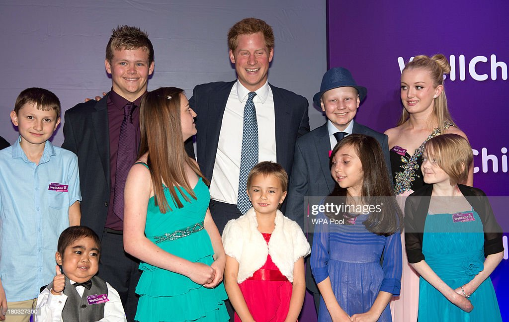 <a gi-track='captionPersonalityLinkClicked' href=/galleries/search?phrase=Prince+Harry&family=editorial&specificpeople=178173 ng-click='$event.stopPropagation()'>Prince Harry</a>, Patron of WellChild (back row, 3rd R) poses on stage with award winners, including Lauren Grace Rogers, age 17(front row, R), Nicole Christou, age 9 (front row 2nd R), Madison Kirk, age 6 (front row 3rd R) and Jonathan He, age 6(front row, L) during the 8th annual WellChild Awards at Dorchester Hotel, Park Lane on September 11, 2013 in London, England. Madison Kirk, from Grantham, who has undergone surgery and months of chemotherapy treatment for anaplastic large cell lymphoma, won an award in the 'Inspirational Child' category. Jonathan He from Milton Keynes won the 'Most Inspirational Child' award for boys aged three to six years old, for his bravery in battling a life-threatening illness. Nicole Christou, from Winchmore Hill, London,, who suffers from the rare condition arterio-venous malformation, received a 'Most Inspirational Child' award. The WellChild national charitable organisation cares for the individual needs of children coping with consequences of serious illness and complex medical conditions.