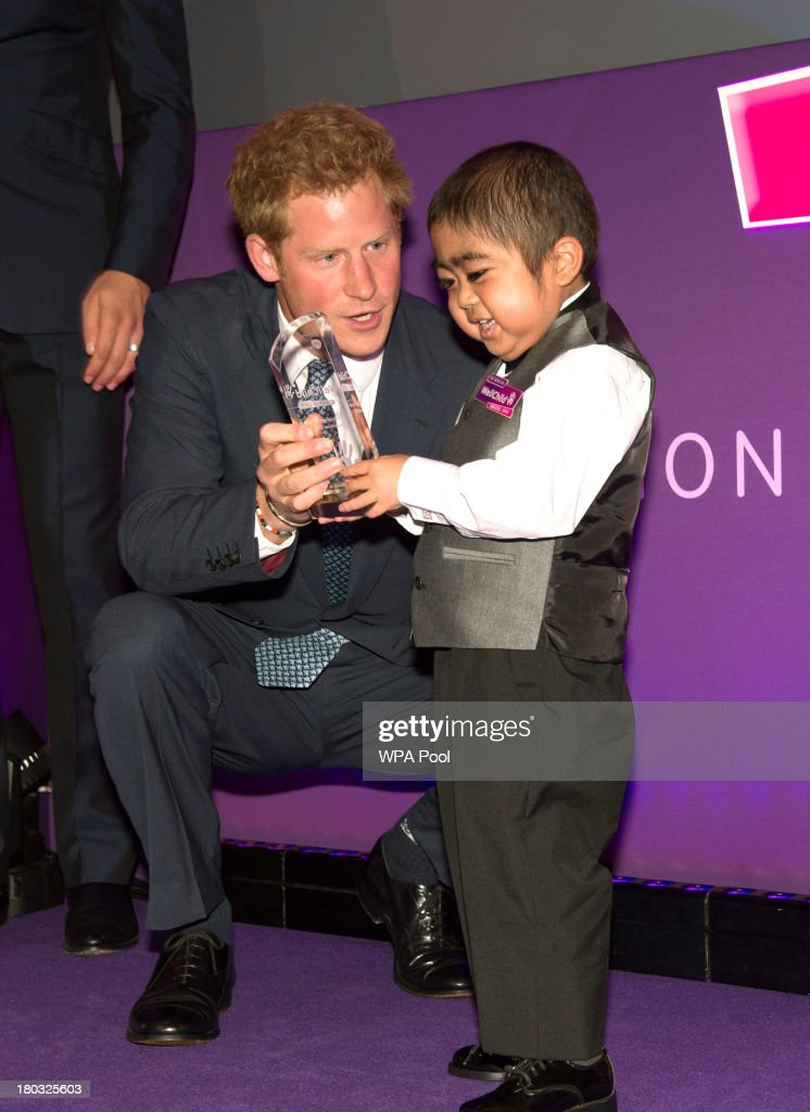 <a gi-track='captionPersonalityLinkClicked' href=/galleries/search?phrase=Prince+Harry&family=editorial&specificpeople=178173 ng-click='$event.stopPropagation()'>Prince Harry</a>, Patron of WellChild (L) presents an award on stage to Jonathan He, age 6, from Milton Keynes, during the 8th annual WellChild Awards at Dorchester Hotel, Park Lane on September 11, 2013 in London, England. Jonathan He won the 'Most Inspirational Child' award for boys aged three to six years old, for his bravery in battling a life-threatening illness. The WellChild national charitable organisation cares for the individual needs of children coping with consequences of serious illness and complex medical conditions.