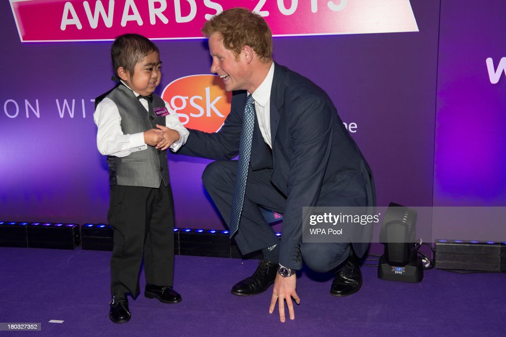 <a gi-track='captionPersonalityLinkClicked' href=/galleries/search?phrase=Prince+Harry&family=editorial&specificpeople=178173 ng-click='$event.stopPropagation()'>Prince Harry</a>, Patron of WellChild (R) presents an award on stage to Jonathan He, age 6, from Milton Keynes, during the 8th annual WellChild Awards at Dorchester Hotel, Park Lane on September 11, 2013 in London, England. Jonathan He won the 'Most Inspirational Child' award for boys aged three to six years old, for his bravery in battling a life-threatening illness. The WellChild national charitable organisation cares for the individual needs of children coping with consequences of serious illness and complex medical conditions.