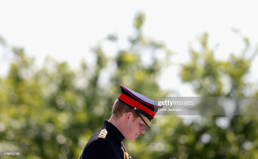 Prince Harry pays his respects at the unveiling of the Bastion Memorial at The National Memorial Arboretum on June 11, 2015 in Stafford, England.