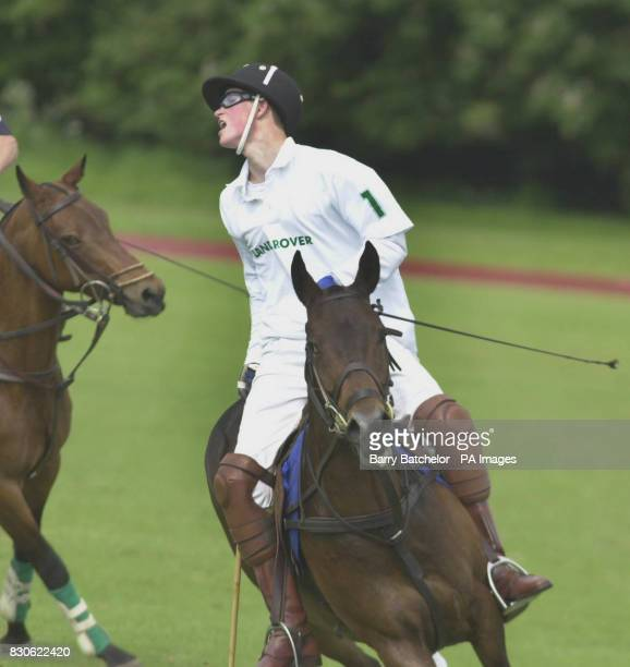 Prince Harry playing on the same team Beaufort as his father the Prince of Wales in a Charity polo match to benefit the Soldiers Sailors Airmen...