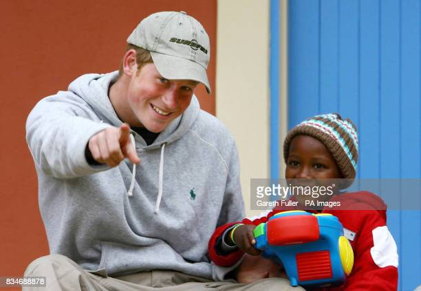 Prince Harry playing with four year old Molise during a visit to the Lesotho Child Counselling Unit in Maseru Lesotho Africa The Lesotho Child...