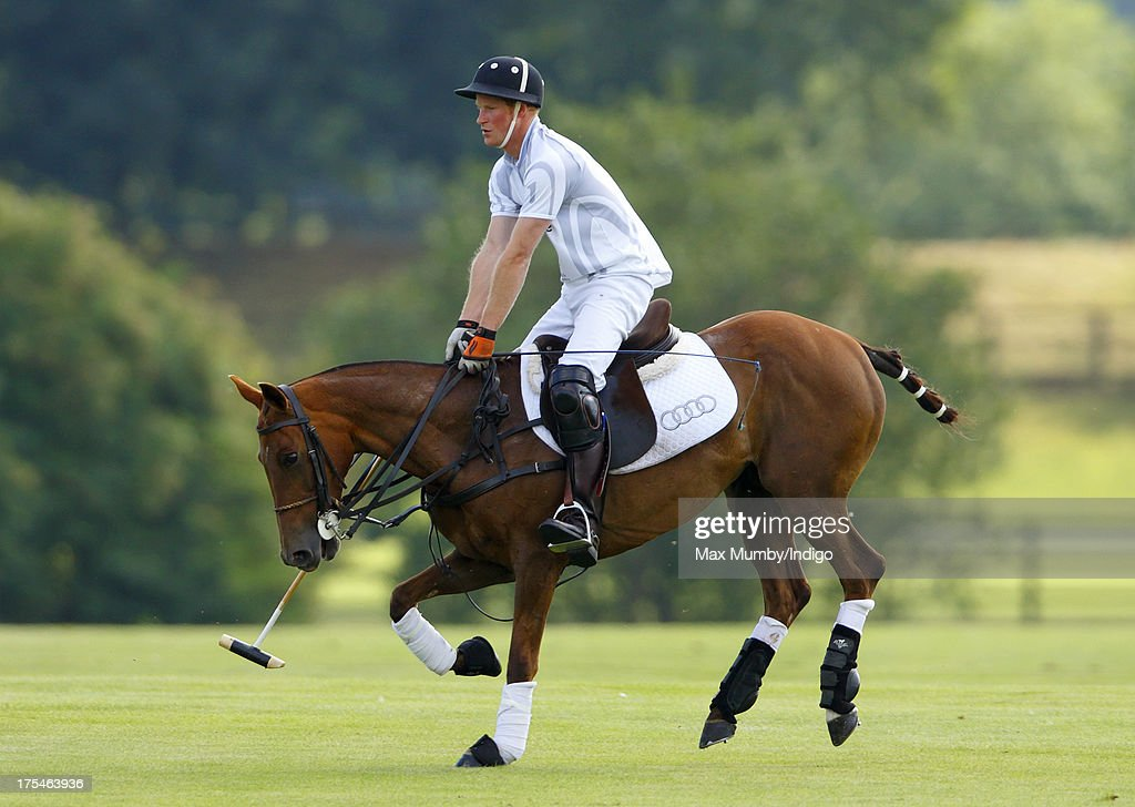 Prince Harry plays alongside his brother Prince William, Duke of Cambridge in the Audi Polo Challenge at Coworth Park Polo Club on August 3, 2013 in Ascot, England.