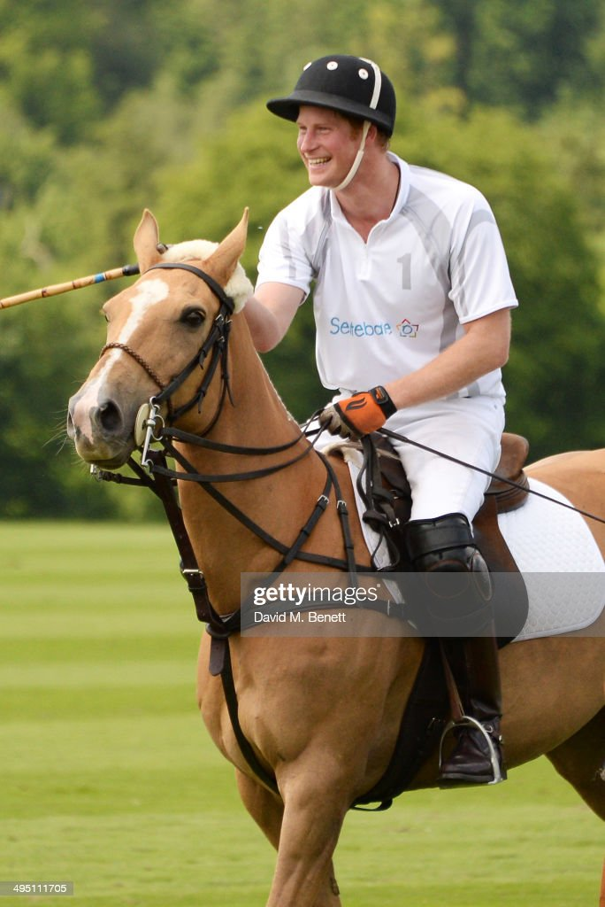 <a gi-track='captionPersonalityLinkClicked' href=/galleries/search?phrase=Prince+Harry&family=editorial&specificpeople=178173 ng-click='$event.stopPropagation()'>Prince Harry</a> plays during day two of the Audi Polo Challenge at Coworth Park Polo Club on June 1, 2014 in Ascot, England.