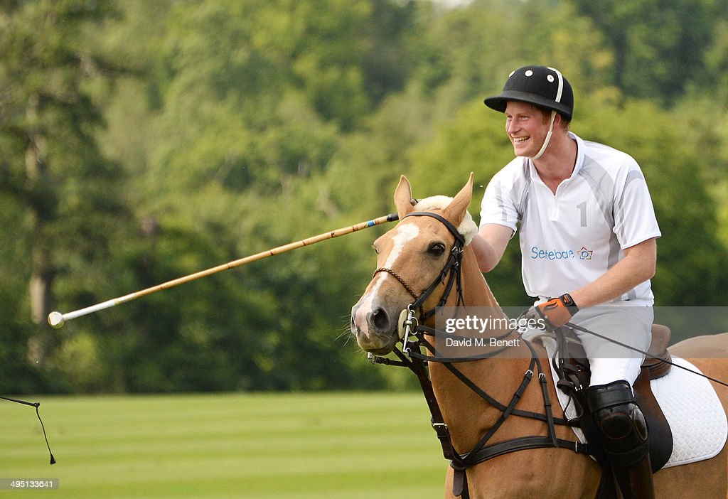 Prince Harry plays during day two of the Audi Polo Challenge at Coworth Park Polo Club on June 1, 2014 in Ascot, England.