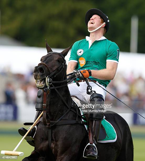 Prince Harry plays for Team BMG in the Maserati Jerudong Park Trophy polo match at Cirencester Park Polo Club on May 24 2015 in Cirencester England