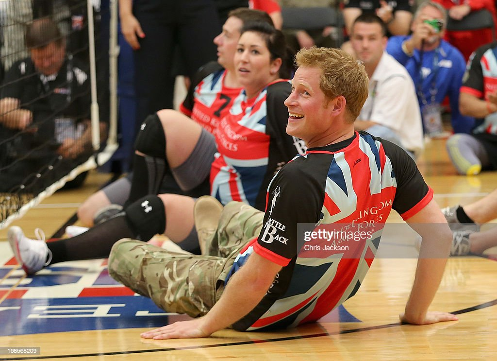 <a gi-track='captionPersonalityLinkClicked' href=/galleries/search?phrase=Prince+Harry&family=editorial&specificpeople=178173 ng-click='$event.stopPropagation()'>Prince Harry</a> plays for the UK team against the USA during a seated vollyball exhibition match during the Warrior Games during the third day of his visit to the United States on May 11, 2013 in Colorado Springs, Colorado. HRH will be undertaking engagements on behalf of charities with which the Prince is closely associated on behalf also of HM Government, with a central theme of supporting injured service personnel from the UK and US forces.