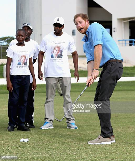 Prince Harry plays golf as he attends a youth sports festival at Sir Vivian Richards Stadium showcasing Antigua and Barbuda's national sports on the...