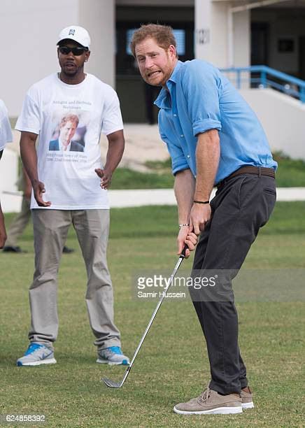 Prince Harry plays golf at Youth Sports Festival at the Sir Vivian Richards Stadium on the second day of an official visit on November 21 2016 in...