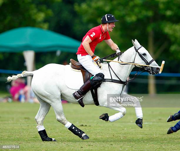 Prince Harry plays in the Army v Navy Rundle Cup Polo Match at Tidwoth Polo Club on July 12 2014 in Tidworth England