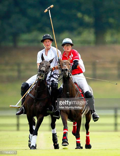 Prince Harry plays in the Audi Polo Challenge at Coworth Park Polo Club on August 4 2013 in Ascot England
