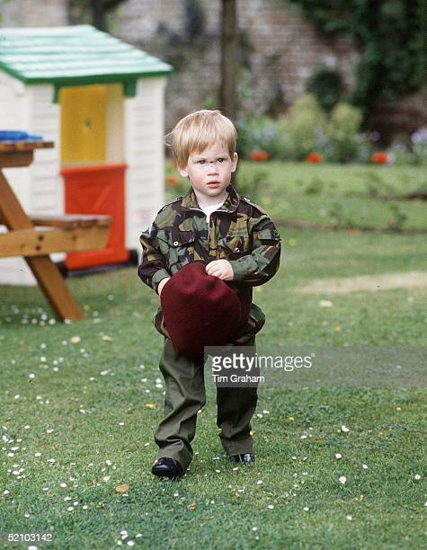 Prince Harry Plays In The Grounds Of His Home Highgrove Dressed In A Parachute Regiment Uniform Showing A Cut On The Bridge Of His Nose From A Fall