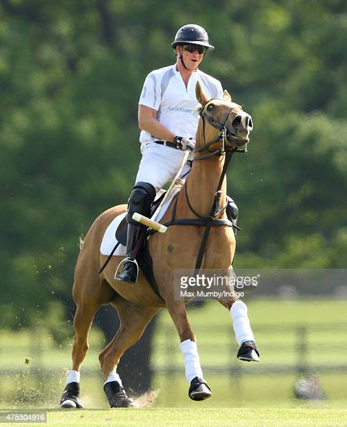 Prince Harry plays polo on day 1 of the Audi Polo Challenge at Coworth Park on May 30 2015 in Ascot England
